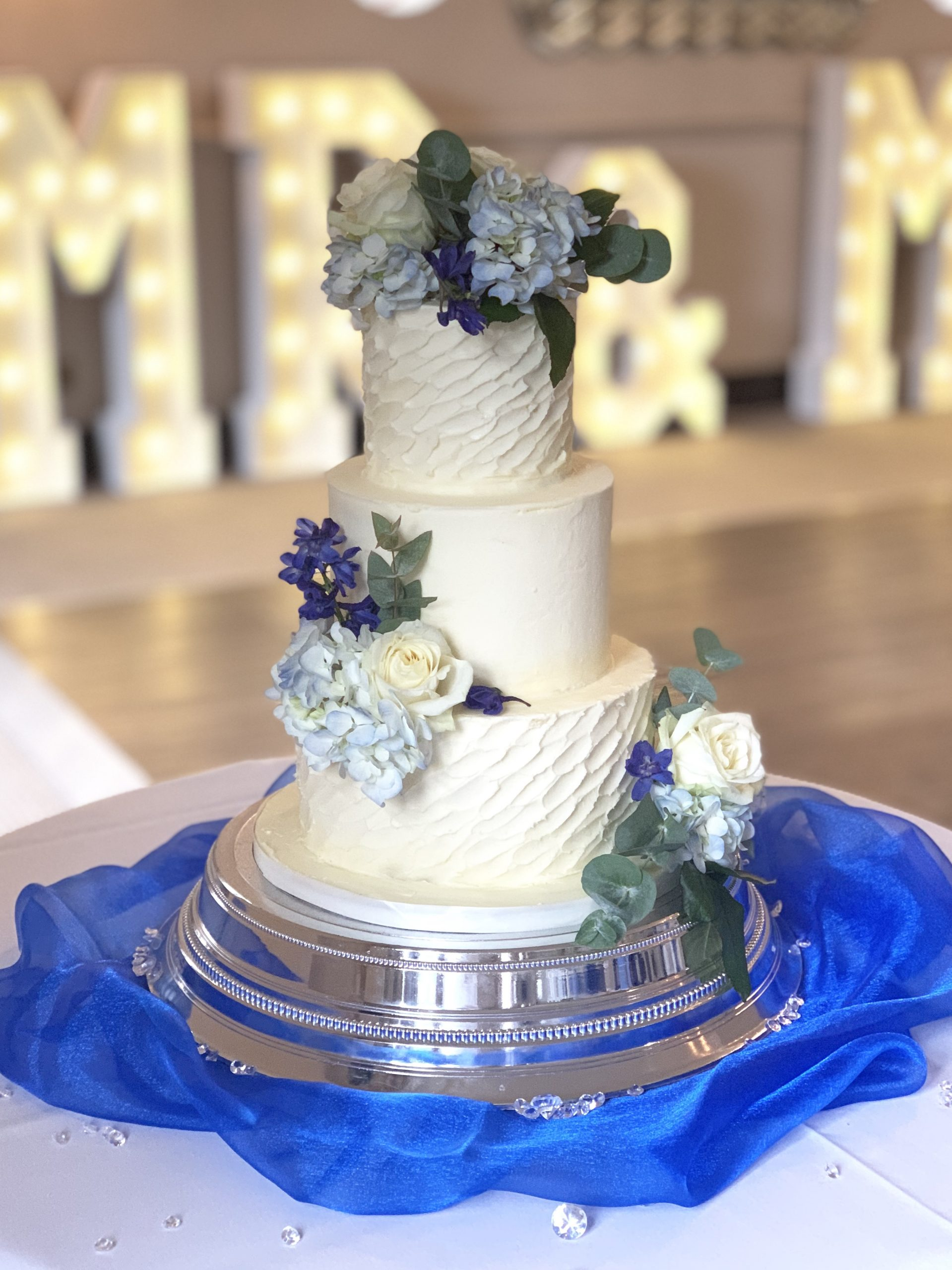 Textured Buttercream Wedding cake with Blue flowers